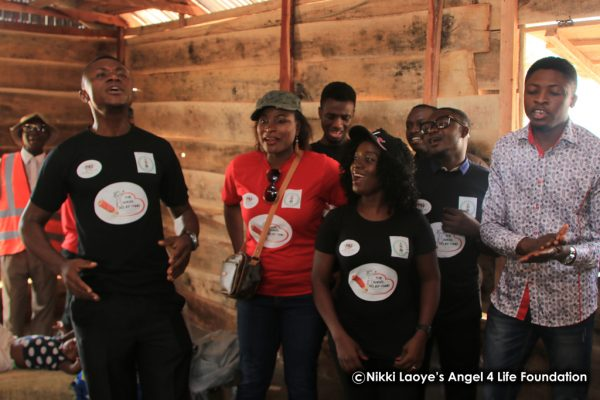 Abuja musicians and Nikki sing for the women and children