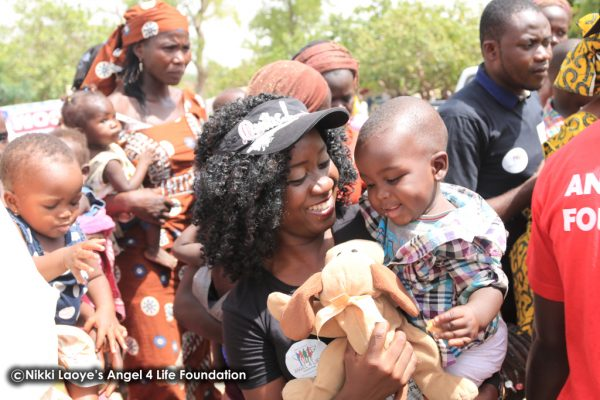 Nikki Laoye & a cute baby all smiles as he gets a toy